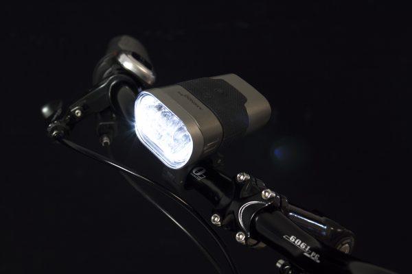 Axendo 60 USB headlamp on handlebar