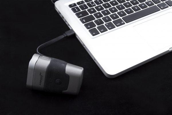 Axendo 60 USB headlamp charging on laptop